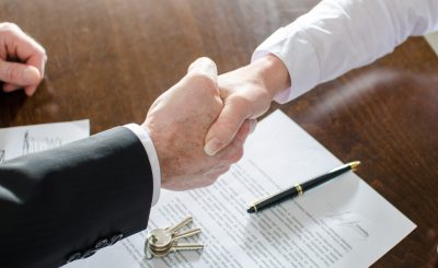 Estate,Agent,Shaking,Hands,With,His,Customer,After,Contract,Signature